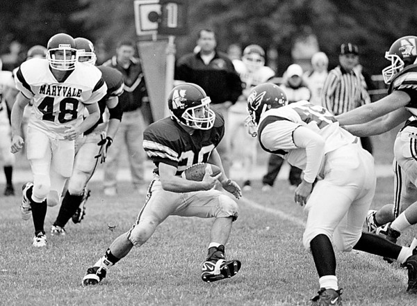 98/10/03 Newfane Football   *Dennis Stierer Photo -<br /> Newfane's #20  tries to dodge some Maryvale players.