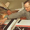 2/21/97- airplane model -- Takaaki Iwabu photo-- Joe Rotella and Doug Webb, members of Niagara Sunday Fliers, work on one of the 25 airplane-models displayed at the Club's annual mall show at Summit Park Mall Friday. (... show will last until Saturday)<br /> <br /> local, Saturday