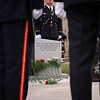 98/09/12 Sheriff memorial 2-Rachel Naber Photo- Jeffery Kolbe stands at attention behind the Sheriff's memorial at the Niagara County Sheriff's department.