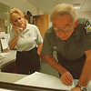97/09/19 State Police--Takaaki Iwabu photo-- Communications specialist Wendy Richards and trooper Leonard Baron work at the State Police's new facility on Dysinger Road in Lockport. <br /> <br /> 1A, color, Saturday