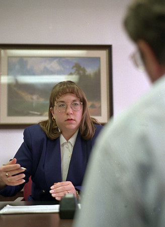 4/10/97-- bankruptcy --Takaaki Iwabu photo-- Regina Reitz, attorney at law, talks to the client (on bankruptcy) at her office on Niagara Falls Blvd. <br /> <br /> Monday, 1A, topic on bankruptcy