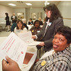 1/28/97 North End Graduation - James Neiss Photo - Mary Price of Center Ave, shows off her certificate of graduation from the Niagara County Community Colledge div9sion of lifelong learning durring a dinner at community missions. In background are L-R Martha Aiduik of 86th street, Noreen Chatmon of Memorial Pky, both graduates and Richelle White, community outreach coordinator for center city.