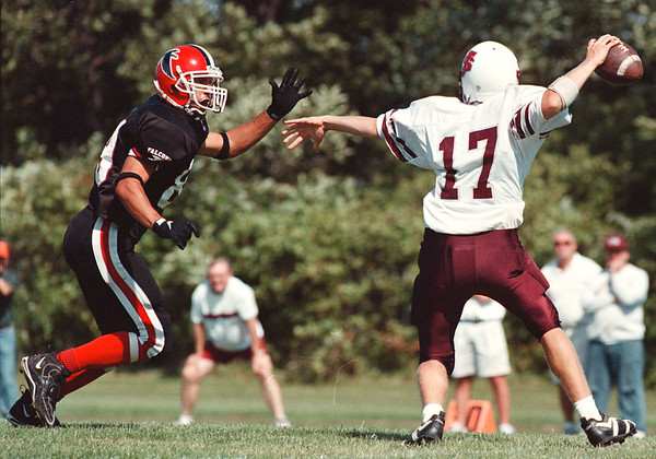 97/09/06-- NW football 1--Takaaki Iwabu photo-- Niagara Wheatfield Frank Pavicich gives a pressure to Saint Joseph's QB Kevin Roland during Saturday's game. <br /> <br /> sports, Sunday, color