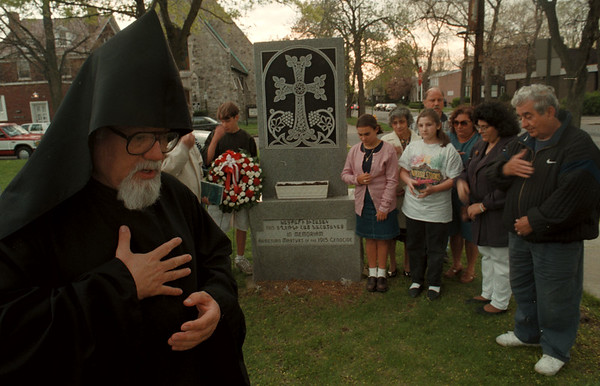 98/04/24--ARMINIAN TRIBUTE--DAN CAPPELALZZO PHOTO--FATHER KEGHAM ZAKARIAN, OF ST SARKIS ARMINIAN CHURCH, LEADS A PRAYER ALONG WITH PARISIONERS AT A MONUMENT AT THE PARK AT PINE AND MAIN.<br /> <br /> 1A