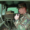 98/01/09 National Guard 1 *Dennis Stierer photo - Staff Sargent Michael Kalinowski checks out the two way radio on one of the service vehicles prior to leaving Lockport enroute to Watertown area.
