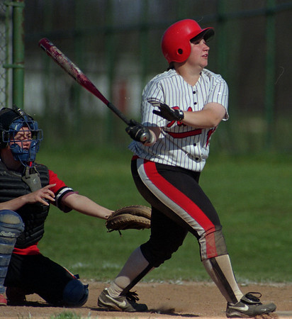 5/22/97--NW Falcons--Takaaki Iwabu photo-- Niagara-Wheatfield Jennifer Severance his a single during Thursday's play-off game against South Park HS. <br /> <br /> sports, Friday