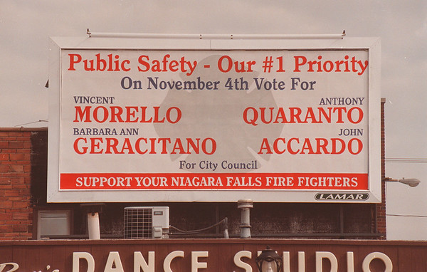 97/10/15 Public Safety Board - James Neiss Photo - Pine Ave Bill Board. Niagara Falls Fire Fighters.