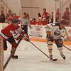 98/01/10--Charity Hockey --Takaaki Iwabu photo-- Buffalo Sabre Alumni Rick Martin, right, takes a shot as Bob Salfi of Damn Yankees defends him during the charity hockey game at Niagara University Arena Saturday. (Proceeds to benefit Grand Niagara Youth Hockey and Hunter's Hope & The Kelly for Kids Foundation.)     --sports, bw, Sunday