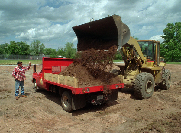 98/06/04 Park Parking - James Neiss Photo - Butts Park to get new parking lot. Here, L-R, Donald Ferris and Roger Holmes, both Heavy equipment operators with the Village of Medina, load the excess dirt onto a truck for removal.