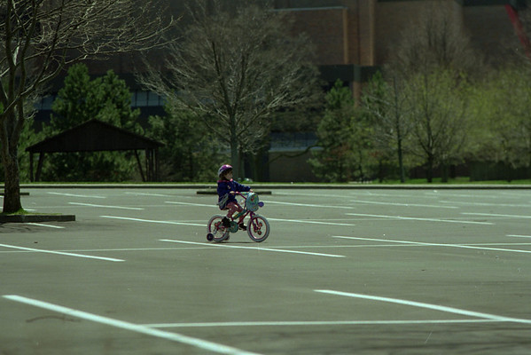 98/04/11Parking Lot Rider *Dennis Stierer photo - Five year old Samantha Yazwinski of Lewiston seems to have the entire parking lot to herself at Artpark on Saturday as she tries out her new bike.