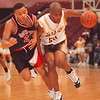 2/26/97-- LaSalle 2  -- tak photo-- Carlos Davis drives toward basket.....