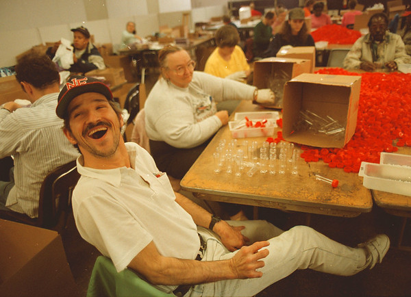 97/10/01---vocational center--Takaaki Iwabu photo-- John Duncan of Niagara Falls shares a laugh with his colegues as he makes testing  pill-bottles at Community Vocational Rehabilitation Center Wednesday. About 100 people work in the Center, which is sponsored by United Cerebral Palsy. <br /> <br /> Grapevine photo