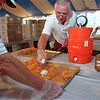 09/09/12 Peach Fest-Rachel Naber photo-Jack Walmsley (left) helps serve peach cobbler after Bill game puts on the finishing touch of whip cream for customers at the Lewiston Peach festival.