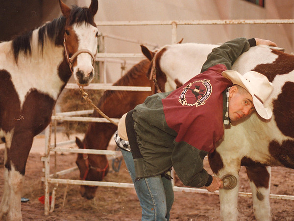 3/15/97-- cowboys --Takaaki Iwabu photo-- A bull rider Terry Ryan of Road Island takes care of horses before the Rodeo Show by All American PRCA Rodeo Co. at Niagara Falls Convention Center Saturday. (feature on present-day cowboys...)<br /> <br /> 1A, Sunday, color