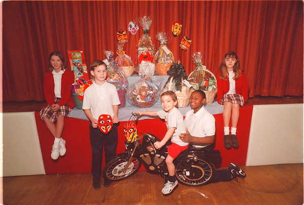 2/4/97 Sacred Heart Auction - James Neiss Photo - Mardi Grass - The  Sacred Heart Home School Association Presents the 3rd Annual Chinese Auction Thursday, Feb. 6th. - Students sit around some off the goodies to be auctioned off.. L-R are: Elyse Boland 11/6, Billy Rougeux 11/6, Dylan Van Epps 4/Pre-K, Richard Posey 11/6 and Angela Thompson 12/6th.