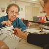 98/02/05--tax file --Takaaki Iwabu photo-- Mary Judson of Lewiston, left, gets a help from Marilyn King on her tax reporting at Lewiston Public Library. King is one of the volunteers from American Association of Retired People. <br /> <br /> money, color, Sunday