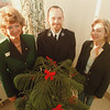 "98/12/04 Mitten Tree - Vino Wong Photo - Pam Caldwell of Marine Midland Bank, Charles Foster of Salvation Army and Janet Lyndaker of MATABC will have a ""mitten tree"" set up for poor people at the Middleport Marine Midland Bank."