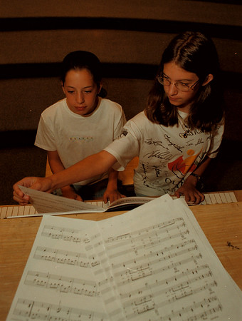 """98/07/27 Music Camp - James Neiss Photo - L-R - Katlyn Gosch 12/7th grade of Pendleton, NY  and  Rachel Stepien 12/7th of Youngstown, NY play a duet of """"Fantom of the Opera"""" musing durring the Music School of Niagara's Summer Music Camp at Abate Elementary. The event was made possible  with public funds from the NYS Council on the Arts in Niagara County."""
