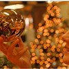 """97/08/28 Christmas & More - Carol McCaughtry, Manager of christmas & More on Millitary Road holds a """"Polonaise"""" Old world glass ornament."""