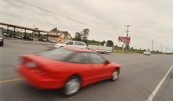 7/21/97--RT 31 TRAFFIC LIGHT--DAN CAPPELLAZZO PHOTO--A SPEEDING CAR DRIVES PAST SMOKIN' JOES ON RT.31 ACROSS FROM NIAGARA WHEATFIELD SCHOOL. A SCHOOL BOARD MEMBER IS CIRCULATING A PETITION TO PUT A LIGHT ON IN FRONT OF THE BUSY GAS BAR.<br /> <br /> LOCAL
