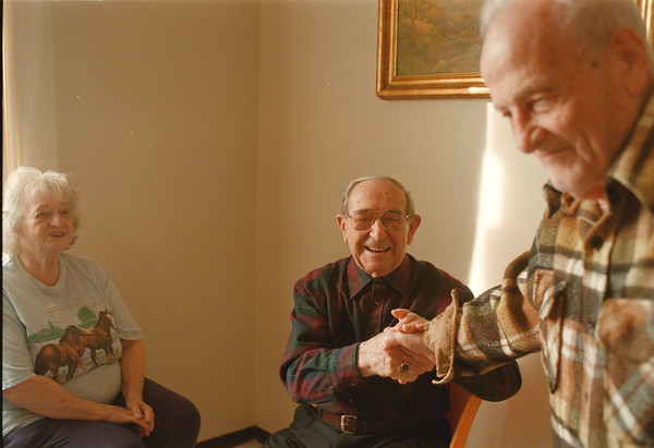 98/01/28-- hand shake --Takaaki Iwabu photo-- Thomas Cornacchia, middle, a 99-year-old Niagara Tower resident, share a laughter with his friends Dorries Armeli, left, and Jim Cardamone Wednesday.