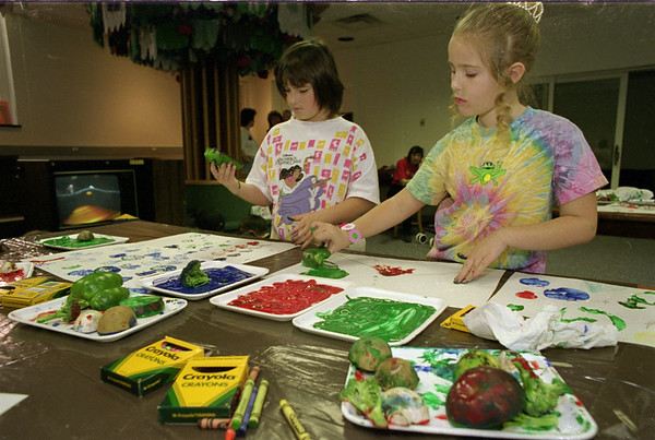 "98/04/18 Earth Day Art *Dennis Stierer photo - Renee"" Patrick, 10 and Alyssa Magee, 7 are making some beautiful art pieces using natural fruits and vegtables instead of  brushes."