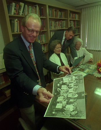 97/09/15 75th Anniversery - James Neiss Photo - L-R - Rev. Dr. Jeffery L. Grove, Pastor of the Bacon Memorial Presbyterian church, looks over old photos to go on display durring the 75th anniversary weekend.  Marlene Dixon, Decon, Robert Dixon, Church Elder and Esther Blessing, a charter member all help out.