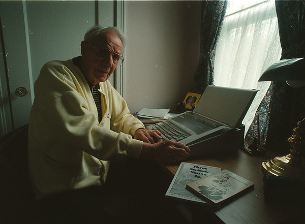 5/16/97 Ralph Hubbell - James Neiss Photo - At Writing Desk showing off just two of his published books.