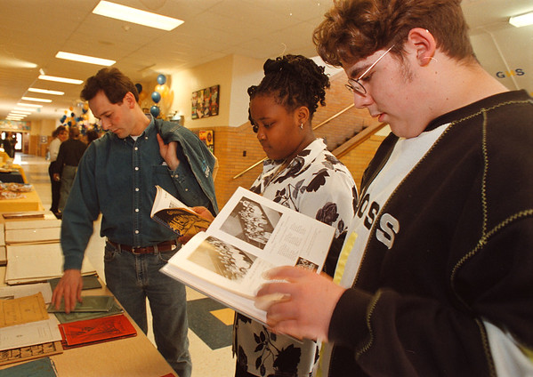 4/18/97 -- Gaskill MS 2 --Takaaki Iwabu photo-- Denisha Osbourne and Ryan Kensinger, 8th graders of Gaskill Middle School, check out the school year books from 1930s, which are diplayed at the School's b-party.