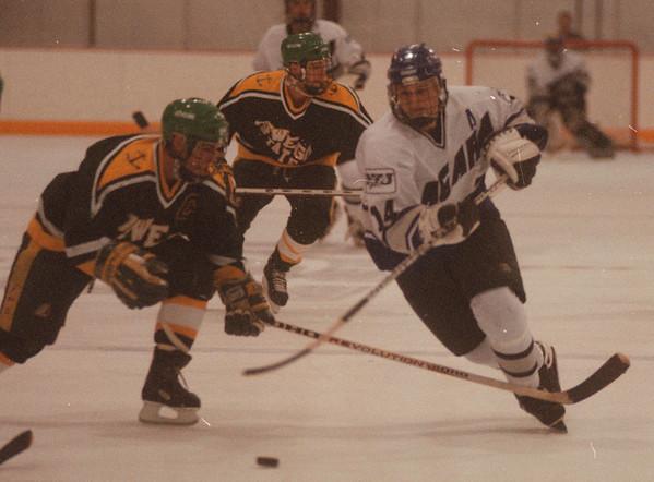 97/11/22-- NU Hockey--Takaaki Iwabu photo-- Niagara University ............... (#14) in action during Saturday's season opener. <br /> <br /> sports, color, Sunday