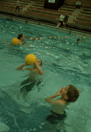97/11/21-- Falcon Aquatics--Takaaki Iwabu photo-- Robert and David LaComb play a ball at Niagara Wheatfield High School pool during Friday's family swim night sponsored by Falcon Aquatics. <br /> <br /> tmc photo