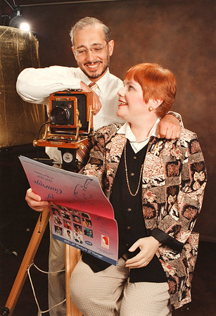97/09/25-- Kifer --Takaaki Iwabu Photo --Al and Kathy Kifer pose at their studio with the calendar they made for fund raising to cancer patients. (They are professional photographers in Lewiston....Kathy herself is fighting with caner....) <br /> <br /> feature, bw, Wednesday