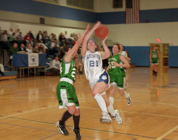 98/02/19 Newfane B'ball *Dennis Stierer photo - Melanie Hicks #21 of Newfane gets a fast break for a lay up as Rosie Luzak #24 of Lew-Port tries to block the shot.