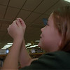 98/12/04 Treading Needle *Dennis Stierer Photo <br /> Nine year old Stephanie Sanders has to use steady hands and lots of patience to get her needle threaded. She was at the Lee Whedon Library, making ornaments.