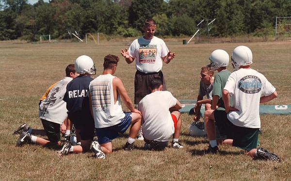97/08/18 LewPort Football 2 - James Neiss Photo - LewPort Head Football Coach Mark Johnson talks to a group durring practice today.