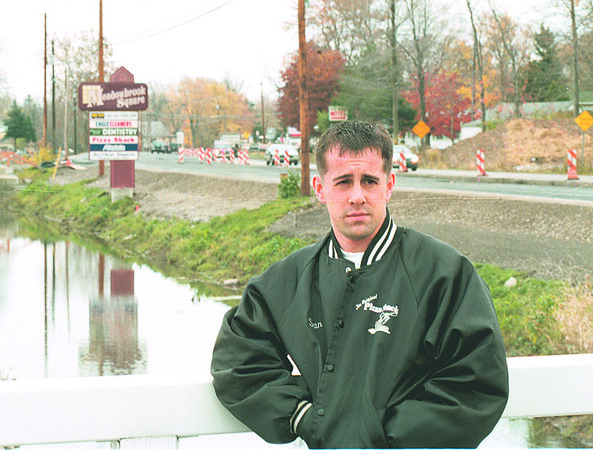 "97/11/07 Construction Disruption - James Neiss Photo - Dan Bailey, Co-owner of ""The Original Pizza Shack"" at the Meadow brook Square Plaza on NF Blvd. is effected by the road construction.  695-0318"