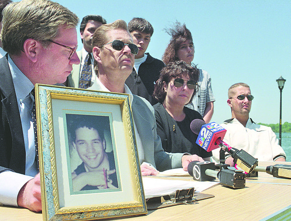 6/14/97-- Kyler law --Takaaki Iwabu photo-- A picture of  Geatano Kyler, who was killed in Niagara River collision five years ago, was placed on table as his family held press conference to promoto the tougher law on drunken boater. Left is Assemblyman Robin Schimminger. <br /> <br /> local, Sunday