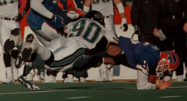 97/12/15--BILLS/COLLINS--DAN CAPPELLAZZO PHOTO--BILLS QB TODD COLLINS IS UP ENDED BY JAGS DEF END TONY BRACKENS IN 2ND HALF ACTION.<br /> <br /> SP