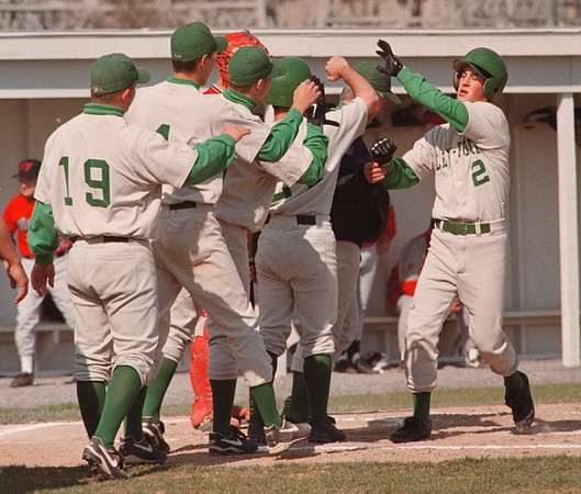 5/13/97--BASEBALL/LEWPORT JUBO--DAN CAPPELLAZZO PHOTO--LEWPORT PITCHER PAT GRAY GETS HIGH FIVES FROM TEAMMATES AFTER A SOLO HOME RUN IN THE 1ST INNING AGAINST NF HIGH AT N.U. FIELD.<br /> <br /> SP