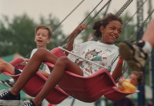 97/08/31-- Field Day--Takaaki Iwabu photo-- A 11-year-old Tanya Nemi of Niagara Falls was all smile as she got on a ride at at Youngstown Field Days in Veteran's Park. <br /> <br /> local, Monday, bw