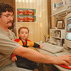 98/02/06--LIGHTSTREAM--DAN CAPPELLAZZO PHOTO--COMPUTER GRAPHICS AND PHOTOGRAPHER AL LIGAMMARI WORKS IN HIS CEDER AVE STUDIO WITH THE HELP OF HIS 18 MONTH OLD SON DOMINIC. LIGAMMARI'S BUSINESS LIGHTSTREAM IS LOCATED IN THE KEY BANK BLDG.<br /> <br /> MONEY MONDAY