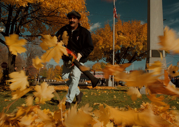 11/11/97-- blow away --Takaaki Iwabu photo-- Arthur Curcione, a worker for Niagara Falls Parks Department, uses a leaf-blower as he cleans up Veterans Park on Main St. before the Veterans Day ceremony Tuesday. <br /> <br /> Grapevine photo