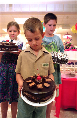 """98/08/14 Cake contest-Rachel Naber Photo-(clockwise) Lacey Owens, age 9, Sam Segar, age 11, and Tommy Clark, age 5 each won the """"you take the cake contest"""" sponsored by Jubilee Foods and Rich products."""