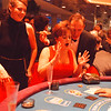 12/7/9-- Casino Niagara--Takaaki Iwabu photo-- Kate Leigh, Port Colborne, Canada, reacts to her loss at Caribian poker table as she plays with Stephanie Freeman, left and Bob O'Dell durring the Saturday's preview of the Casino.(She won big the next game)