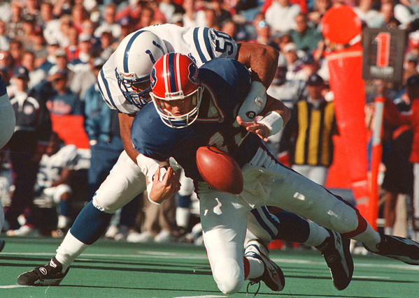 97/09/21-- Bills 1--Takaaki Iwabu photo-- Buffal Bills QB Todd Collins lost control of the ball as Indiana Colts ............ (#50) sacks him during the 2nd quarter of the game. Bills allowed ...... sacks and ....... tourn overs Sunday.