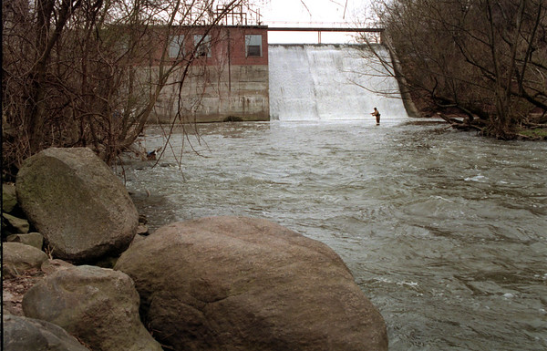 98/04/03 Burt Dam *Dennis Stierer photo - A long fisherman wades the water by the Burt dam in hopes of catching that ever evasive fish.