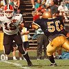 97/10/04-- NW Falcons 2--Takaaki Iwabu photo-- NW QB Jason Herman scrambles out of pocket as Sweet Home Trey Hargrove tries to reach him. <br /> <br /> color, Sunday, Sports
