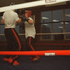 98/12/05 Kick Box-Rachel Naber Photo-AmerAbdallah (left) demonstrates sparring with pupil, Jared Ulrich at the grand opening of his kick boxing studio at 30 pine Street in lockport.