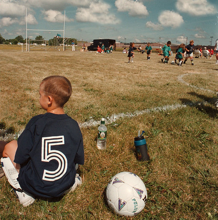 7/21/97--WAITING IN THE WINGS--DAN CAPPELLAZZO PHOTO--5-YR-OLD JOEL COSTANZO, OF TEAM CANADA, WAITS TO GET INTO THE GAME DURING LITTLE LEAGUE SOCCER ACTION AT LASALLE HIGH FIELD Tuesday AFTERNOON.<br /> <br /> GRAPE
