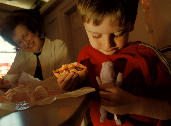 98/05/23-- beanie baby --Takaaki Iwabu photo-- A 5-year-old Marc Morreale of Lewiston looks at the beanie baby he got as he and his grandmother Phyllis Infantino dine at McDonald's in Lewiston Saturday. <br /> <br /> local, Sunday, bw  with color promo